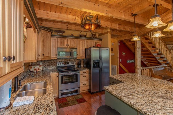 Kitchen with stainless appliances and granite counters at Mystic Ridge, a 4 bedroom cabin rental located in Pigeon Forge
