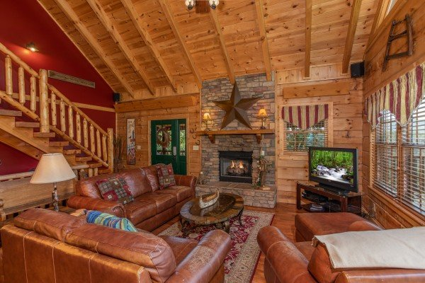 Living room with fireplace and TV at Mystic Ridge, a 4 bedroom cabin rental located in Pigeon Forge