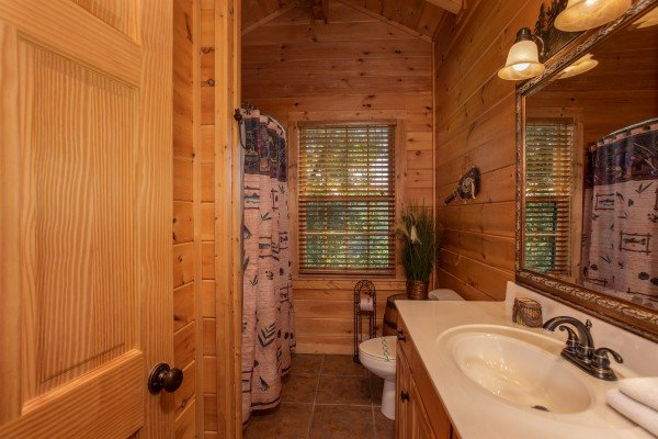 Bathroom with a tub and shower at Mystic Ridge, a 4 bedroom cabin rental located in Pigeon Forge