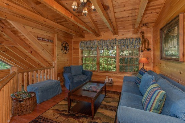 Sitting area in the loft with a sleeper sofa at Mystic Ridge, a 4 bedroom cabin rental located in Pigeon Forge