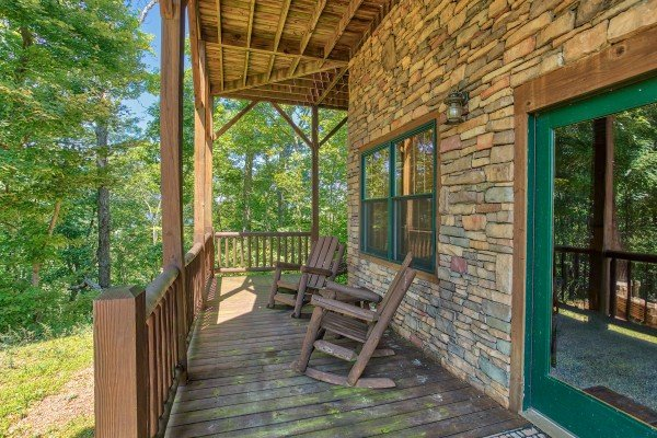 Deck with rocking chairs at Mystic Ridge, a 4 bedroom cabin rental located in Pigeon Forge
