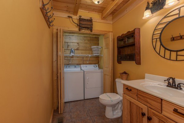 Bathroom with a washer and dryer on the main floor at Mystic Ridge, a 4 bedroom cabin rental located in Pigeon Forge