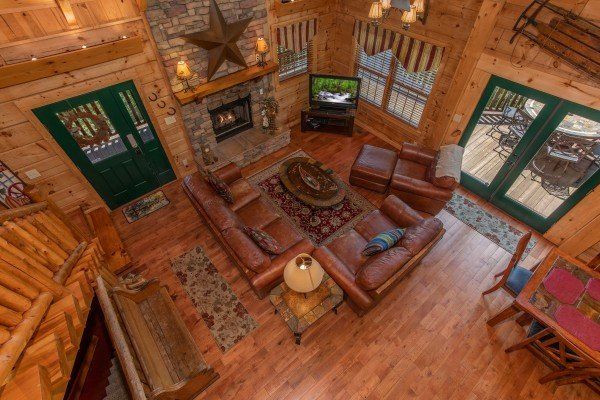 Looking down into the main living room from the upper floor at Mystic Ridge, a 4 bedroom cabin rental located in Pigeon Forge