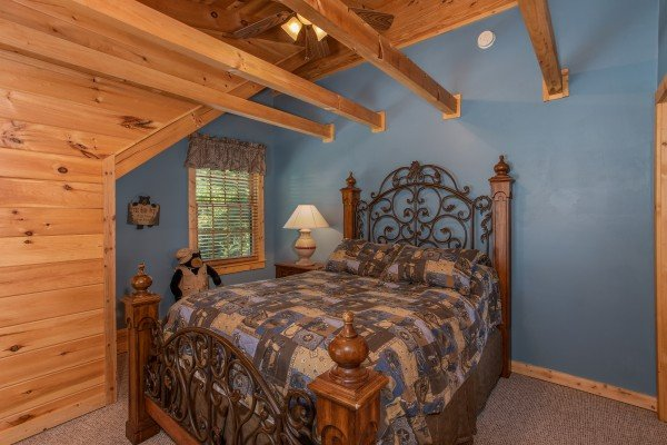 Queen bedroom on the third floor at Mystic Ridge, a 4 bedroom cabin rental located in Pigeon Forge