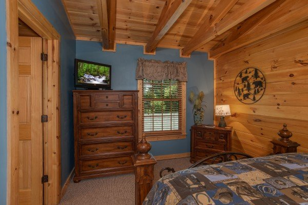 Queen bedroom with a dresser and TV at Mystic Ridge, a 4 bedroom cabin rental located in Pigeon Forge