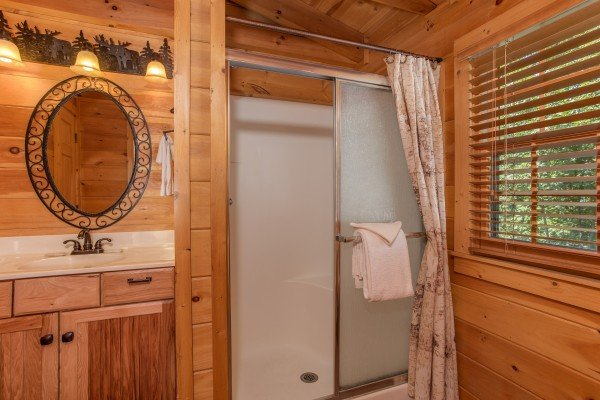 Queen bedroom en suite bath with a shower at Mystic Ridge, a 4 bedroom cabin rental located in Pigeon Forge