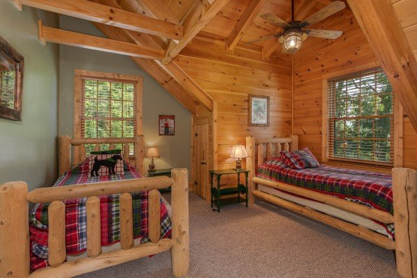 Double twin beds in a loft bedroom at Mystic Ridge, a 4 bedroom cabin rental located in Pigeon Forge