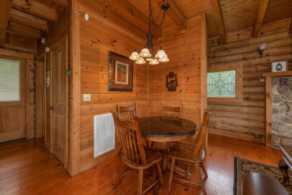 Dining table for four at Romantical Rendeviews, a 1 bedroom cabin rental located in Pigeon Forge
