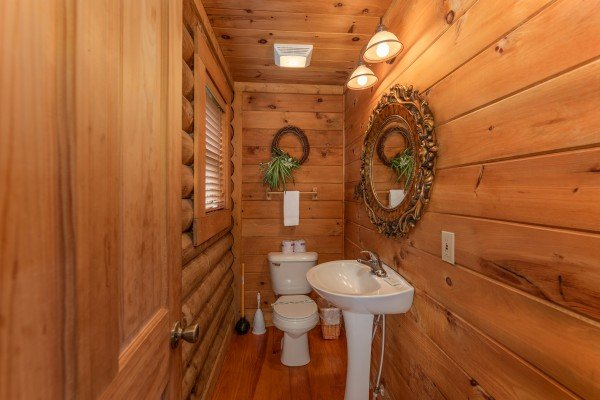 Half bath at Romantical Rendeviews, a 1 bedroom cabin rental located in Pigeon Forge