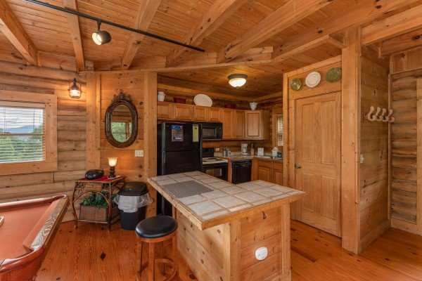 Kitchen with breakfast bar at Romantical Rendeviews, a 1 bedroom cabin rental located in Pigeon Forge