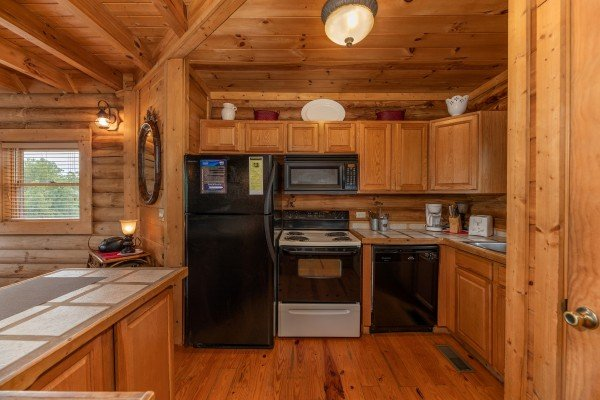 Kitchen with black appliances at Romantical Rendeviews, a 1 bedroom cabin rental located in Pigeon Forge