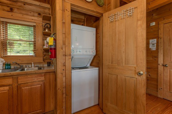 Stacked washer and dryer at Romantical Rendeviews, a 1 bedroom cabin rental located in Pigeon Forge
