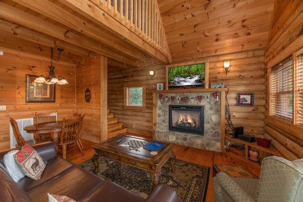 Living room with fireplace & TV at Romantical Rendeviews, a 1 bedroom cabin rental located in Pigeon Forge