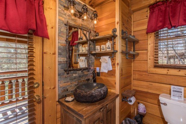 Custom vanity in the bathroom, next to the deck access at Dancing Bearfoot, a 2-bedroom cabin rental located in Pigeon Forge