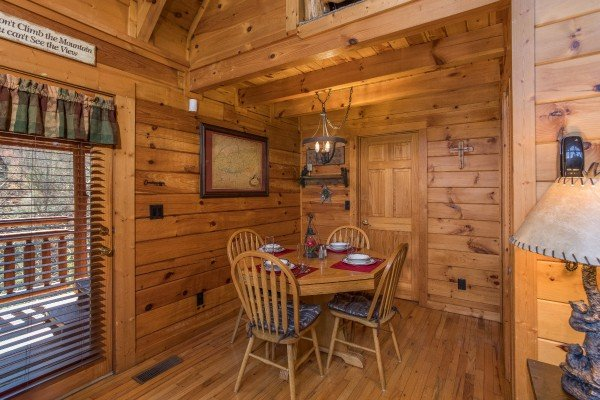 Dining table with seating for four at Dancing Bearfoot, a 2-bedroom cabin rental located in Pigeon Forge