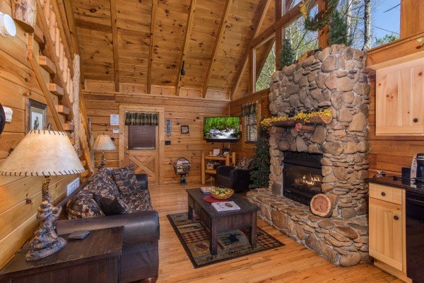 Looking across the open concept living room at Dancing Bearfoot, a 2-bedroom cabin rental located in Pigeon Forge