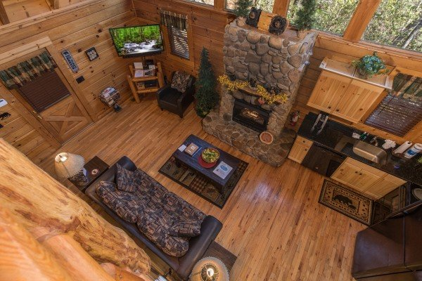 Looking down at the open concept first floor from upstairs at Dancing Bearfoot, a 2-bedroom cabin rental located in Pigeon Forge