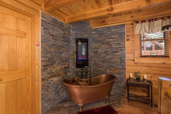 Copper soaking tub in the queen bedroom at Dancing Bearfoot, a 2-bedroom cabin rental located in Pigeon Forge