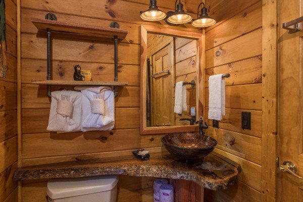 Loft bathroom with custom sink and vanity at Dancing Bearfoot, a 2-bedroom cabin rental located in Pigeon Forge