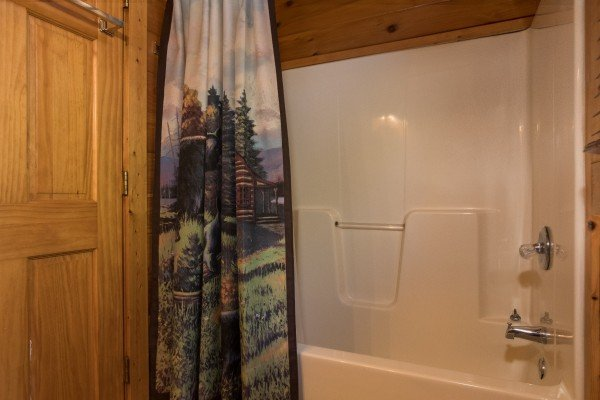 Tub and shower at Dancing Bearfoot, a 2-bedroom cabin rental located in Pigeon Forge