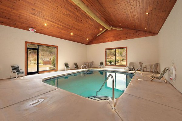 Indoor pool access for guests at Better View, a 4 bedroom cabin rental located in Pigeon Forge