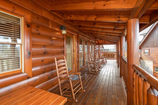 Covered deck with rocking chairs at Better View, a 4 bedroom cabin rental located in Pigeon Forge