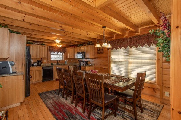 Dining space for ten at Better View, a 4 bedroom cabin rental located in Pigeon Forge