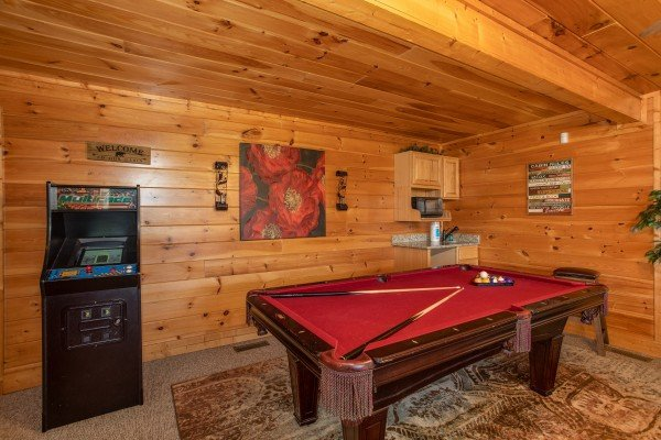Pool table and arcade game at Better View, a 4 bedroom cabin rental located in Pigeon Forge