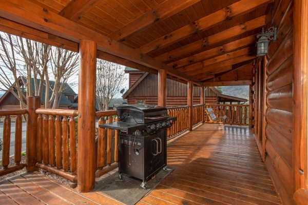 Grill on a covered deck at Better View, a 4 bedroom cabin rental located in Pigeon Forge