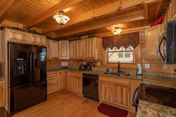 Kitchen with black appliances at Better View, a 4 bedroom cabin rental located in Pigeon Forge