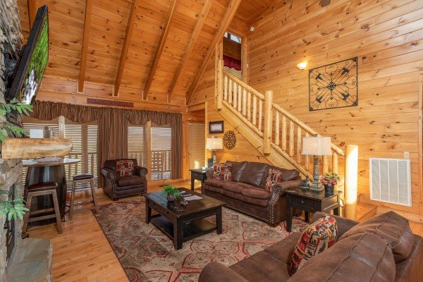 Queen sleeper sofa and additional seating in the living room at Better View, a 4 bedroom cabin rental located in Pigeon Forge