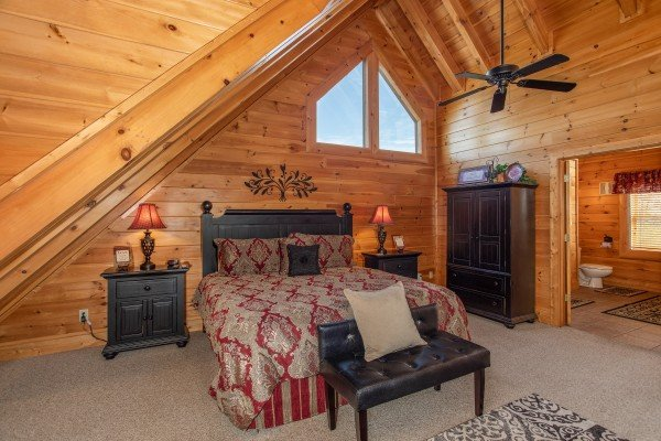 King bed with two nights stands and an armoire in the loft at Better View, a 4 bedroom cabin rental located in Pigeon Forge