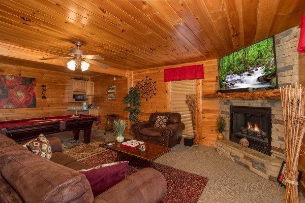 Lower level second living room with fireplace and TV at Better View, a 4 bedroom cabin rental located in Pigeon Forge
