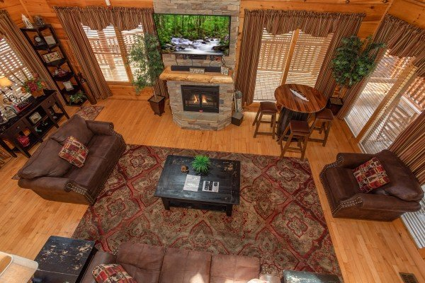 Looking down on the living room from the upper floor at Better View, a 4 bedroom cabin rental located in Pigeon Forge
