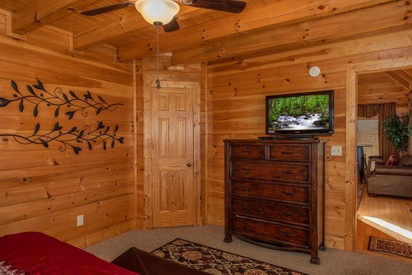 Dresser and TV in a bedroom at Better View, a 4 bedroom cabin rental located in Pigeon Forge