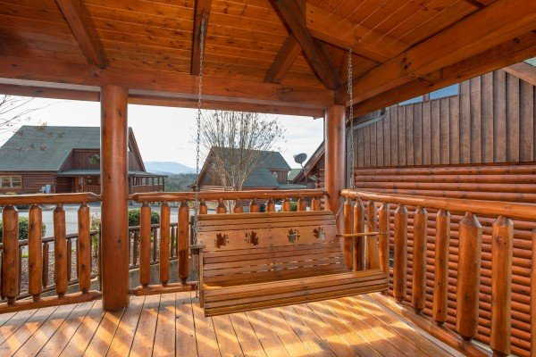 Porch swing at Better View, a 4 bedroom cabin rental located in Pigeon Forge