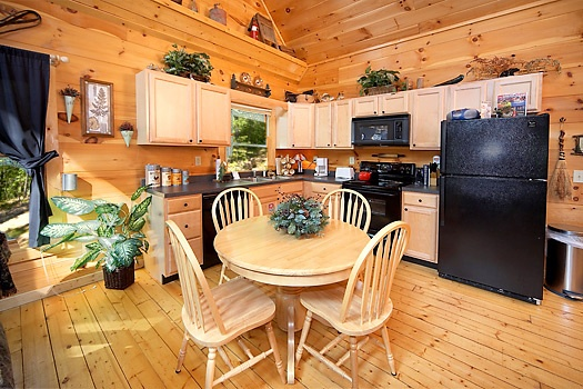 Kitchen and table at 2 Lovin' Bears, a 1 bedroom cabin rental located in Gatlinburg