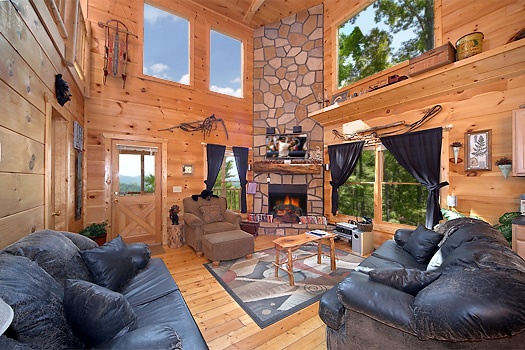 Living room fireplace at 2 Lovin' Bears, a 1 bedroom cabin rental located in Gatlinburg