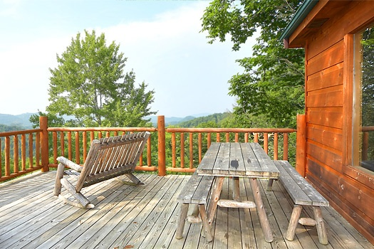 Picnic table on deck at 2 Lovin' Bears, a 1 bedroom cabin rental located in Gatlinburg