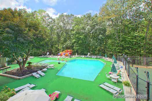 Community pool access for guests at Terrace Garden Manor, a 13 bedroom cabin rental located in Gatlinburg
