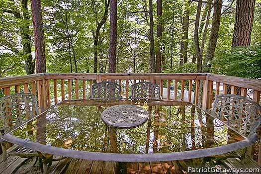 Deck dining area at Terrace Garden Manor, a 13 bedroom cabin rental located in Gatlinburg