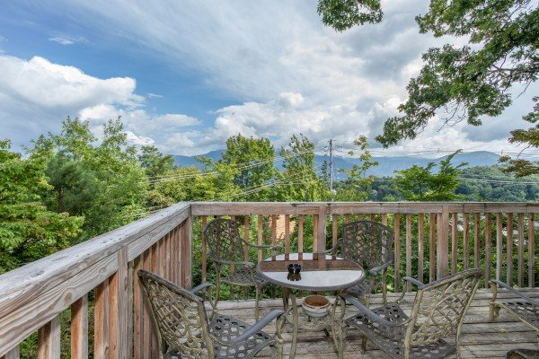 Mountain views from a deck dining table at Terrace Garden Manor, a 13 bedroom cabin rental located in Gatlinburg