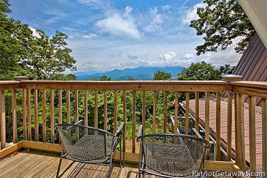 Smoky Mountain views from the deck at Terrace Garden Manor, a 13 bedroom cabin rental located in Gatlinburg