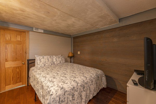 Bedroom with a dresser and TV at Terrace Garden Manor, a 13 bedroom cabin rental located in Gatlinburg