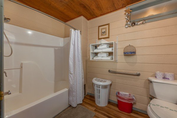 Bathroom with a tub and shower at Terrace Garden Manor, a 13 bedroom cabin rental located in Gatlinburg