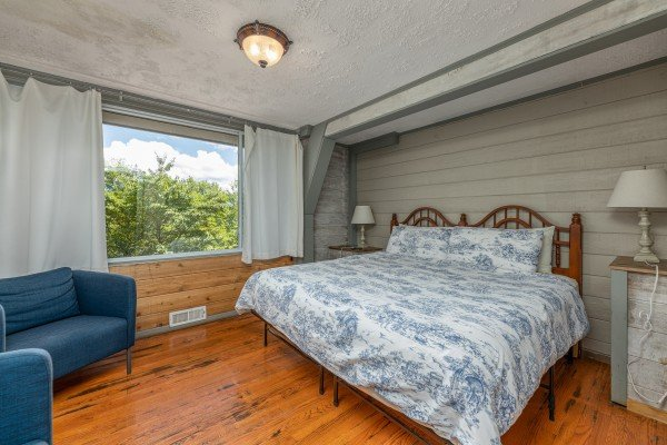 Bedroom with a king bed at Terrace Garden Manor, a 13 bedroom cabin rental located in Gatlinburg