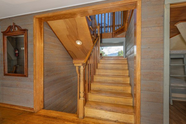 Staircase at Terrace Garden Manor, a 13 bedroom cabin rental located in Gatlinburg