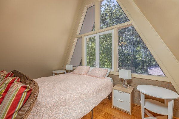 Bedroom with bed, two night stands and lamps at Terrace Garden Manor, a 13 bedroom cabin rental located in Gatlinburg