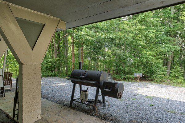 Grill off the carport at Terrace Garden Manor, a 13 bedroom cabin rental located in Gatlinburg