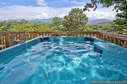 Smoky Mountain views from the hot tub at Terrace Garden Manor, a 13 bedroom cabin rental located in Gatlinburg
